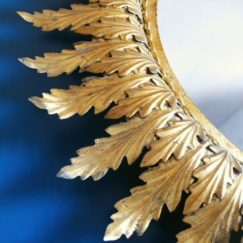 Gran espejo sol en forja dorada al pan de oro, vintage 60s.