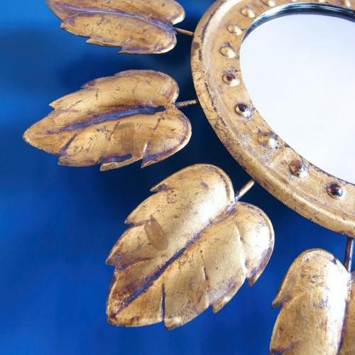 Espejo sol en forja dorada, vintage 60s.