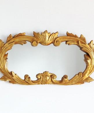 Espejo barroco de madera tallada y dorada al pan de oro. Vintage siglo XX.
