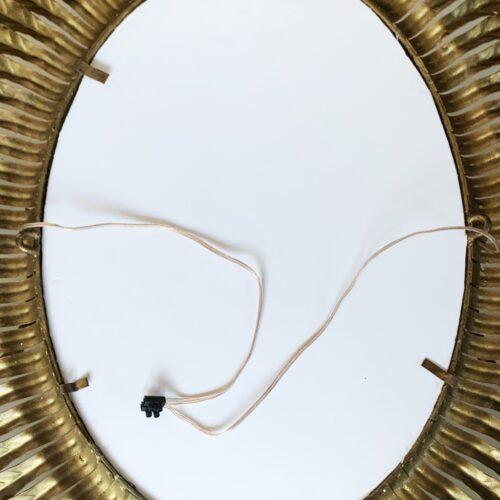 Singular espejo sol con luces. Diseño de hojas, forja dorada. Vintage años 60.